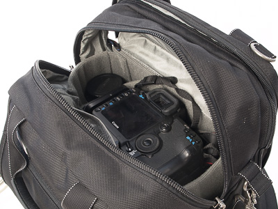 Camera with lens in main compartment