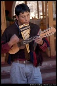 Peruvian musician playing the zampona and charango. Sacred Valley, Peru.