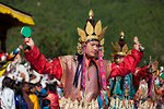 Dancer with damaru (small drum) and dribu (bell). Thimphu tsechu, Bhutan.