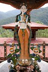 Sculpture of goddess holding a teapot at Khamsum Yuelley Namgyal Chorten. Punakha Valley, Bhutan.