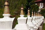 Row of chortens at Khamsum Yuelley Namgyal Chorten. Punakha Valley, Bhutan.