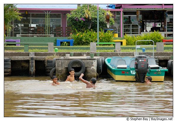 Children playing in the water. Toruguero village, Costa Rica.