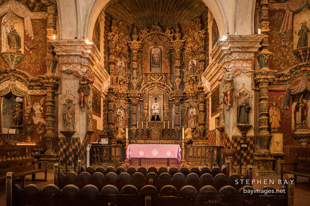 The main altar and reredos of the mission is dedicated to Saint Francis Xavier. Mission San Xavier Del Bac, Tucson Arizona.
