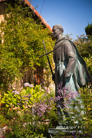 Statue of Junipero Serra in the garden. Carmel Mission, California.