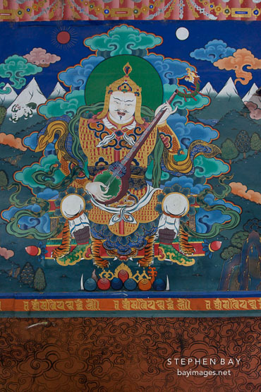 Painting of Yulkhorsung, the white king of the east, playing the lute. Paro Dzong, Bhutan.