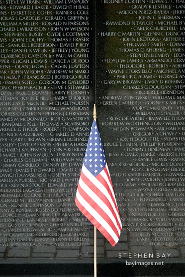 American flag at the Vietnam Veteran's Memorial Wall. Washington, D.C., USA.