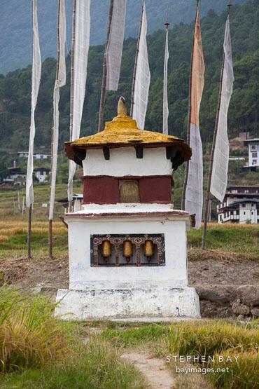 Chorten with three prayer wheels. Sopsokha, Bhutan.