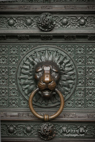 Bronze lion knocker on the Cologne Cathedral. Cologne, Germany.