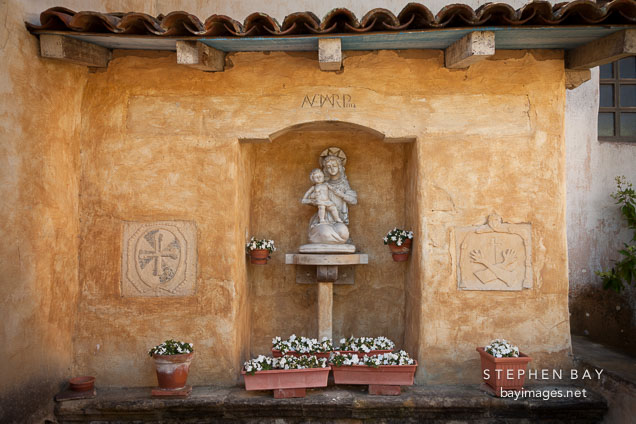 Prayer alcove with mother Mary and Jesus. Carmel Mission, California.
