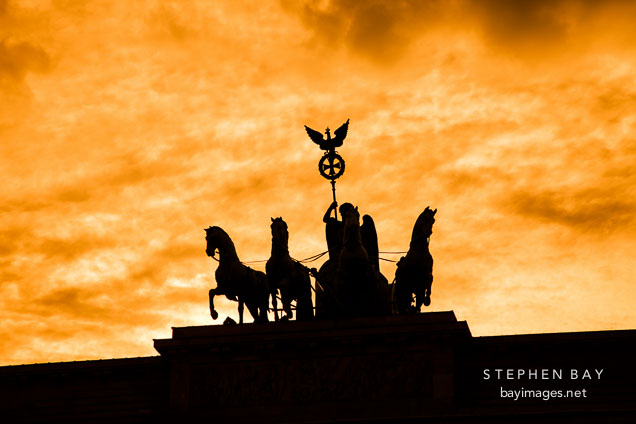 Silhouette of Quadriga, a four horse chariot driven by the goddess Victoria.