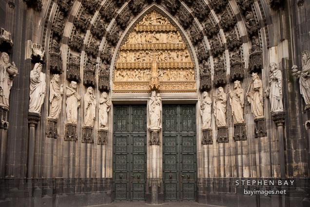 Old and new testament figures on the sides of the hauptportal. Cologne Cathedral, Germany.