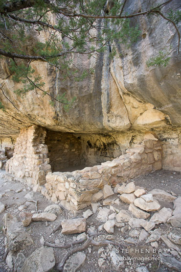Sinagua room built in the shelter of a limestone overhang. Walnut Canyon, Arizona.