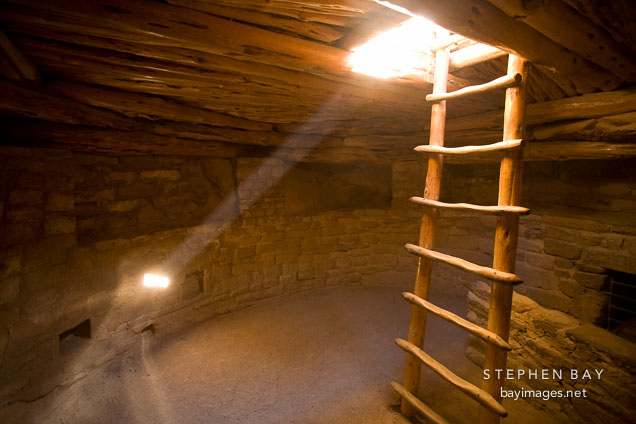 Light shines through the inside of a kiva. Spruce Tree House, Mesa Verde NP, Colorado.