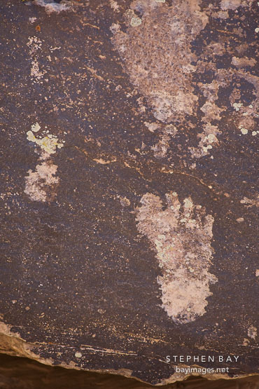 Petroglyph of footprint at Puerco Pueblo, Petrified Forest NP, Arizona.