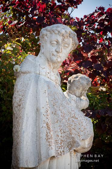 Statue of St Anthony of Padua holding Jesus. Carmel Mission, California.