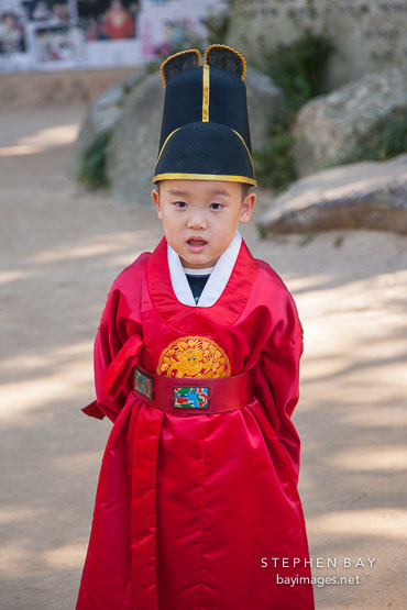 A Korean school boy models an outfit that is similar to that which Confucian scholars traditionally wore.