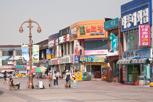 Pedestrians stroll the boardwalk in Wolmido, Incheon, South Korea.