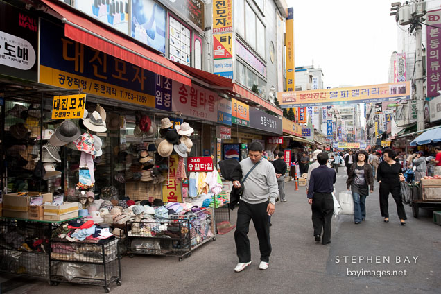 The Namdaemun Market in Seoul is nearly always packed with shoppers. In addition to the hats pictured here, the market offers thousands of other items.