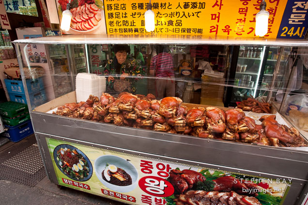 A vendor at the Namdaemun Market in Seoul sells pork.