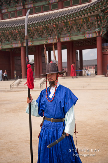 Guard with polearm at Gyeongbok Palace in Seoul, South Korea.