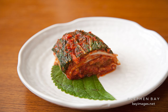 Kimchi is one of the most popular foods in Korea. Basic kimchi is made by mixing cabbage, radish, red chili pepper, green onions, garlic, ginger and fish sauce, and then fermenting the mixture.