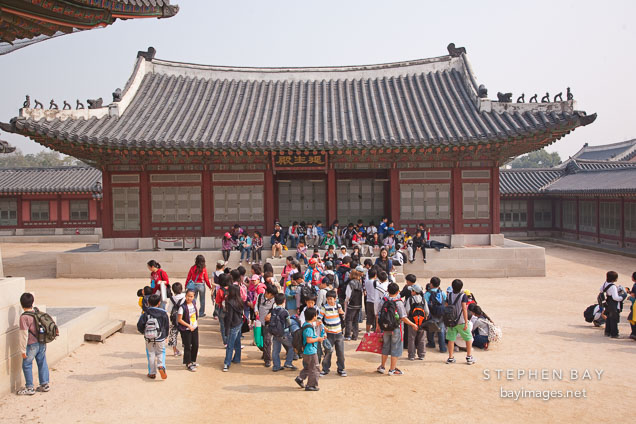 Group of school children at Gyeongbokgung Palace. Seoul, South Korea.