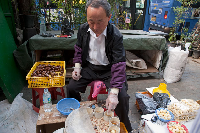 Man selling chestnuts near Dongdaemun market. Seoul, South Korea.