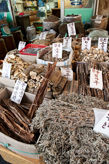Herbs for sale in a market stall at Gyeongdong Herbal Medicine. Seoul, South Korea.
