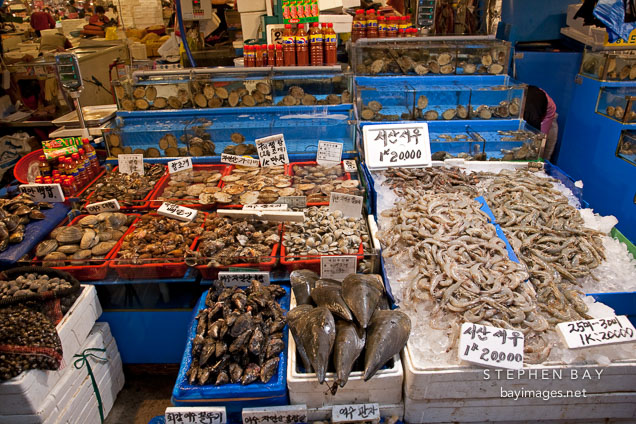 An overflowing stall awaits shoppers at the Noryangjin Fish Market in Seoul.