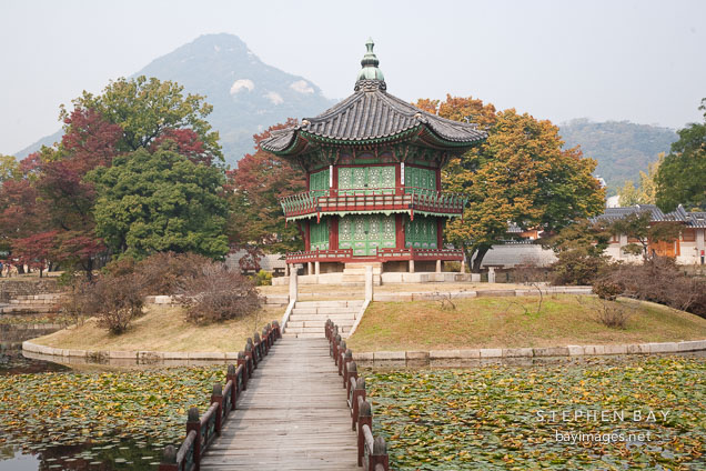 A two-story pavilion overlooks Hyangwonjeong pond at Gyeongbok Palace in Seoul, South Korea.