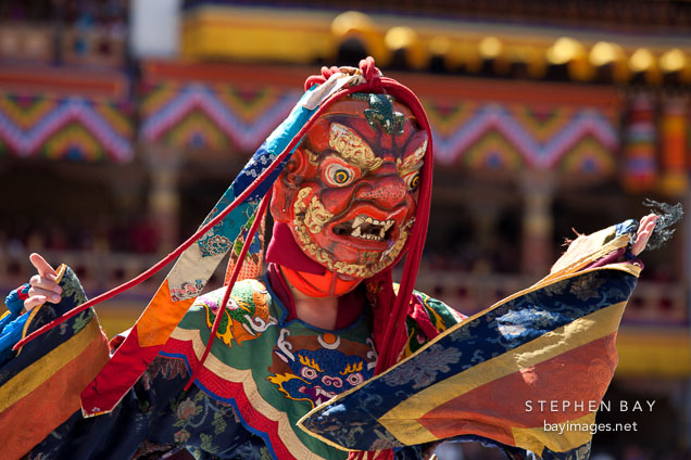 Dancer with frightening mask and brocade dress. Thimphu tsechu, Bhutan.