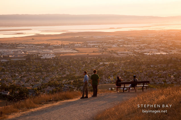 Hikers watching the sunset over the Bay Area. Mission Peak, California.