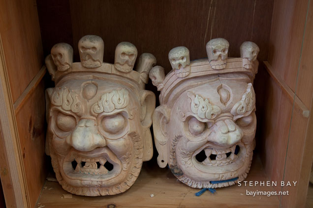 Unpainted masks with minature skulls. National Institute for Zorig Chusum, Thimphu, Bhutan.