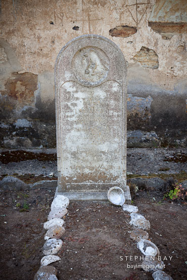 Tombstone of Old Gabriel, a native american who allegedly lived 151 years old. Carmel Mission, California.
