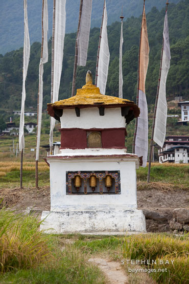 Chorten with three prayer wheels. Sopsokha, Bhutan.