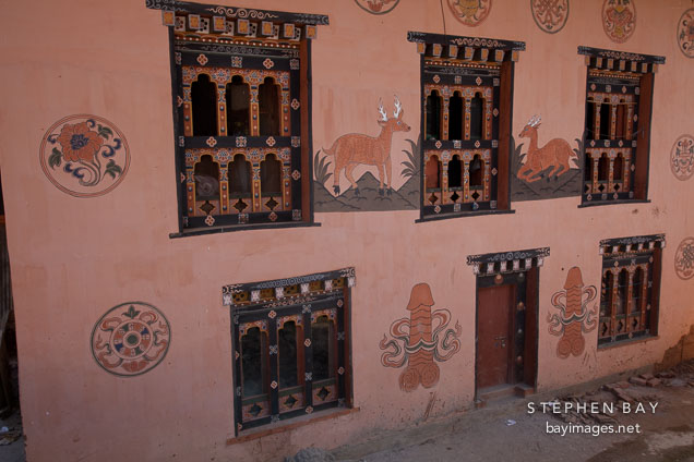 Farmhouse in Sopsokha, Bhutan decorated with paintings.