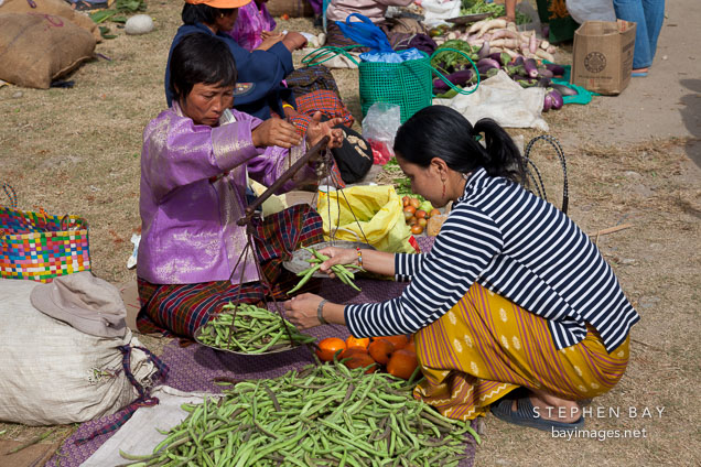 Weighing green beans at the weekend market. Punakha, Bhutan.