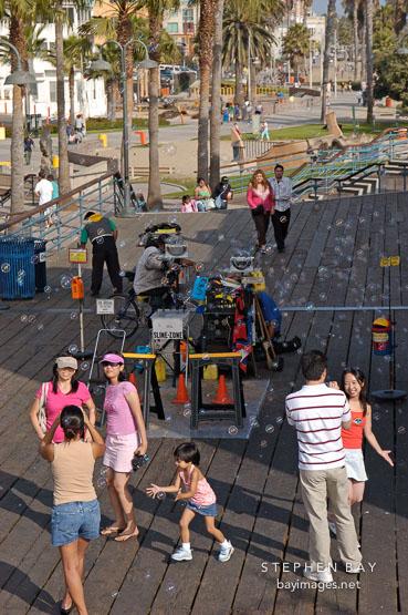 Bubble machine on the Santa Monica pier. Santa Monica, California, USA.
