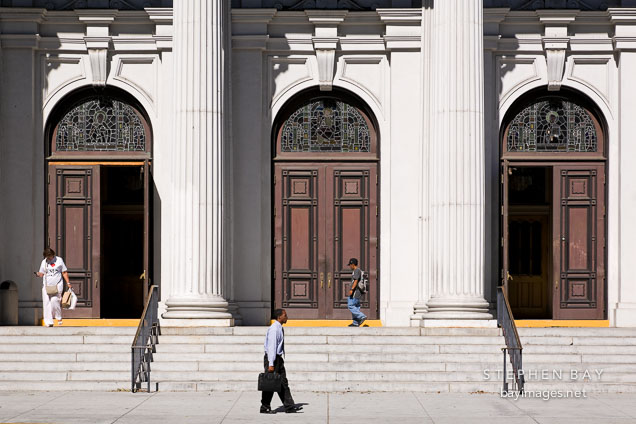 People walking by the church doors. Cathedral Basilica of St. Joseph, San Jose, California.