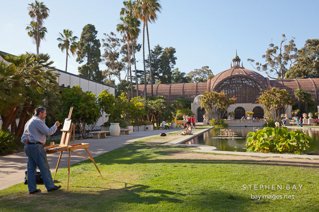 Man painting the botanical building. Balboa Park, San Diego.