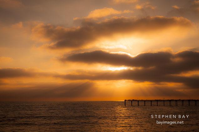 Clouds and Ocean beach pier. San Diego, California.