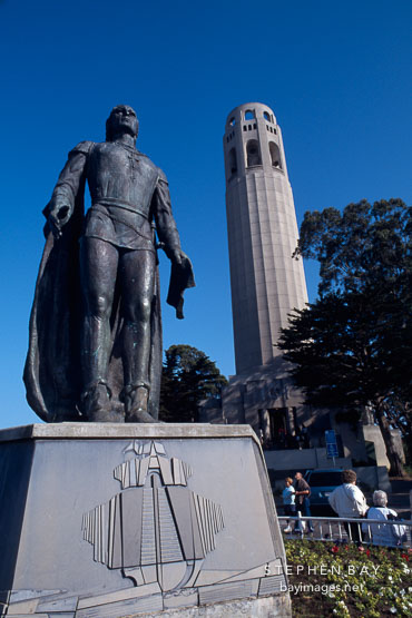 Statue of Christopher Columbus and Coit Tower. San Francisco, California, USA.