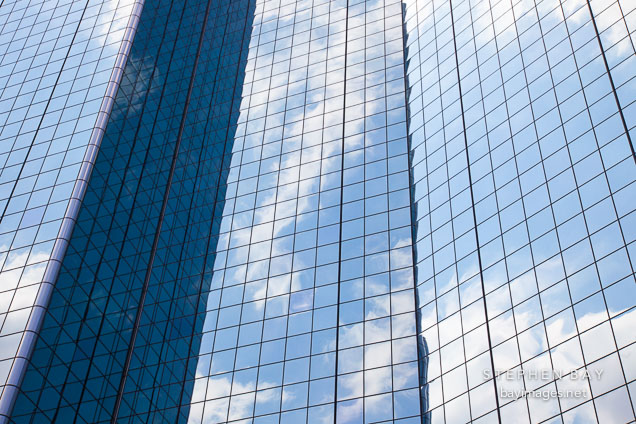 Clouds and sky reflected on the glass windows of the Hyatt Regency. Dallas, Texas.
