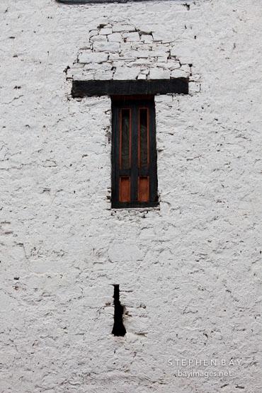 Arrow slit and window at Rinpung Dzong. Paro, Bhutan.