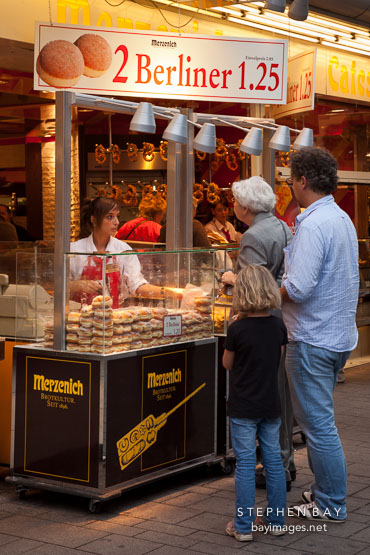 Selling Berliner doughnuts. Cologne, Germany.