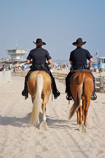 Police patroling on horseback. Venice, California, USA.
