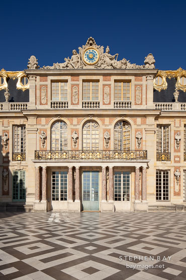 Marble court and Palace of Versailles. Versailles, France.