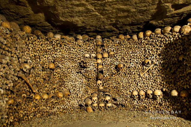 Photo: Skulls and bones stacked to the ceiling in the catacombs. Paris ...