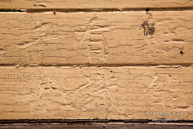 Chinese characters carved into wood and painted over. Angel Island Immigration Station.