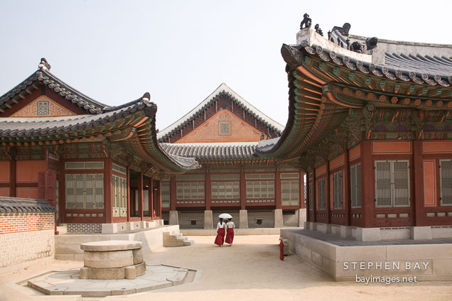Women Wearing Traditional Korean Hanboks Stroll Through The Grounds Of Gyeongbok Palace In Seoul South